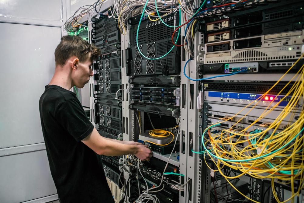 technician rewiring cables